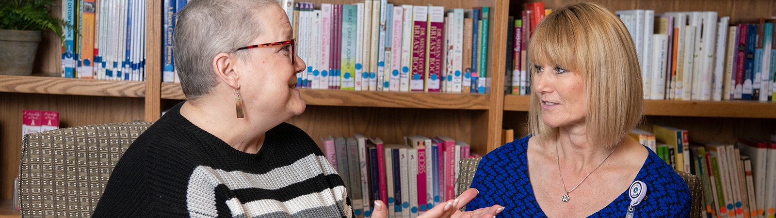 A woman meeting with a Cancer Navigator to help her through her cancer journey